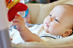 Baby laying in bouncer chair Stock Photo