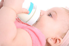 Baby laying down drinking bottle Royalty Free Stock Photos