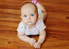 Baby laying on the   floor Royalty Free Stock Images