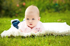Baby laying on grass Royalty Free Stock Photos