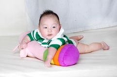 Baby laying on a pillow Stock Photo