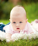 Baby laying on towel Royalty Free Stock Photos