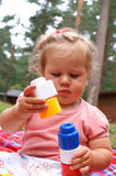 Baby lays blocks Stock Photo