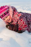 Baby lays on snow Royalty Free Stock Photo