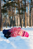 Baby lays on snow in wood Royalty Free Stock Photos