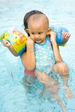 Baby learn to swim Stock Image