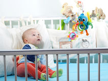 Baby learning through senses in cot stock image