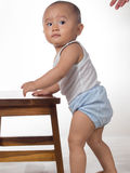 Baby learning to stand Stock Photography