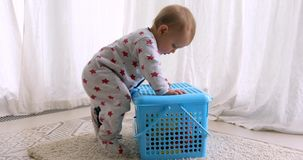 Baby learning to stand up. At home stock footage