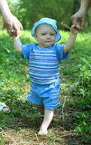 Baby learning to walk. Cute toddler learning to walk Stock Images