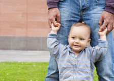 Baby learning to walk Stock Images