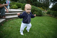Baby learning to walk. Baby is learning to walk alone outside royalty free stock image
