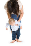 Baby learning to walk Stock Photography