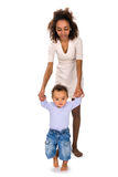 Baby learning to walk Stock Photos