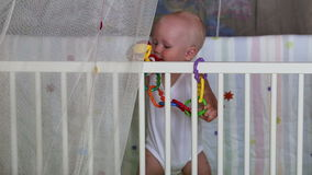 Baby learns to stand holding support stock video