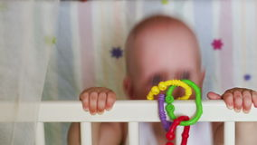 Baby learns to stand holding support stock footage