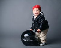 Baby in leather jacket with a moto helmet Royalty Free Stock Photography