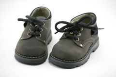 Baby leather shoes. Grey toddler shoes on withe Royalty Free Stock Photo