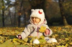 Baby with leaves Stock Photo