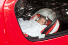 Baby sleeping in car stock photo