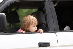 Baby left alone in a car. Waiting for parents. Stock Image