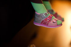 Baby legs. Green tights, pink sandals Stock Photos