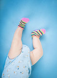 Baby legs on blue background Royalty Free Stock Image