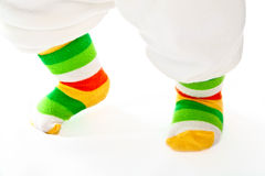Baby legs in sport striped socks. Stock Photography