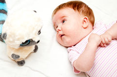 Baby with lemur toy. Cute baby girl with her lemur soft toy Royalty Free Stock Photography