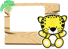 Baby leopard on wooden board Stock Images