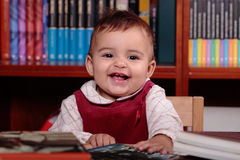 Baby in library Royalty Free Stock Image