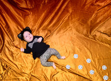 Baby lies in a leopard suit Royalty Free Stock Photography