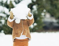 Baby lift big snowball Stock Images