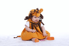 Baby with a lion mask Royalty Free Stock Photos