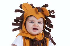 Baby with a lion mask Royalty Free Stock Photo