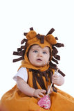 Baby with a lion mask Royalty Free Stock Image