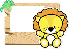 Baby lion on wooden board Royalty Free Stock Photos