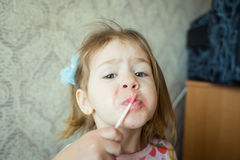 Baby with lipstick. Portrait of little girl with lipstick Stock Images