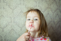 Baby with lipstick Royalty Free Stock Image