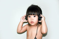 Baby listen music from headphone Royalty Free Stock Photo