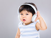 Baby listen to music Stock Image