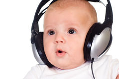 Baby Listens To Music Stock Images