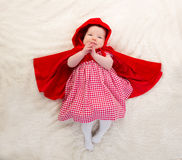 Baby Little Red Riding Hood on white fur Royalty Free Stock Photos