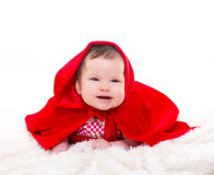 Baby Little Red Riding Hood on white fur Royalty Free Stock Image