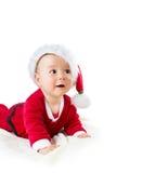 Baby lokalisiert auf weißem Hintergrund in Sankt-Kostüm Lizenzfreies Stockbild