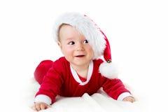 Baby lokalisiert auf weißem Hintergrund in Sankt-Kostüm Stockbild