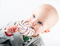 Baby with lollipop Royalty Free Stock Image