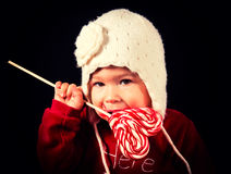 Baby with lolly pop Royalty Free Stock Images