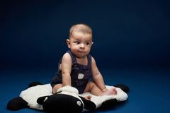 Baby look in copy space. On blue studio background stock photo