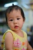 Baby look. Ing,home shot. Thai baby girl royalty free stock photos